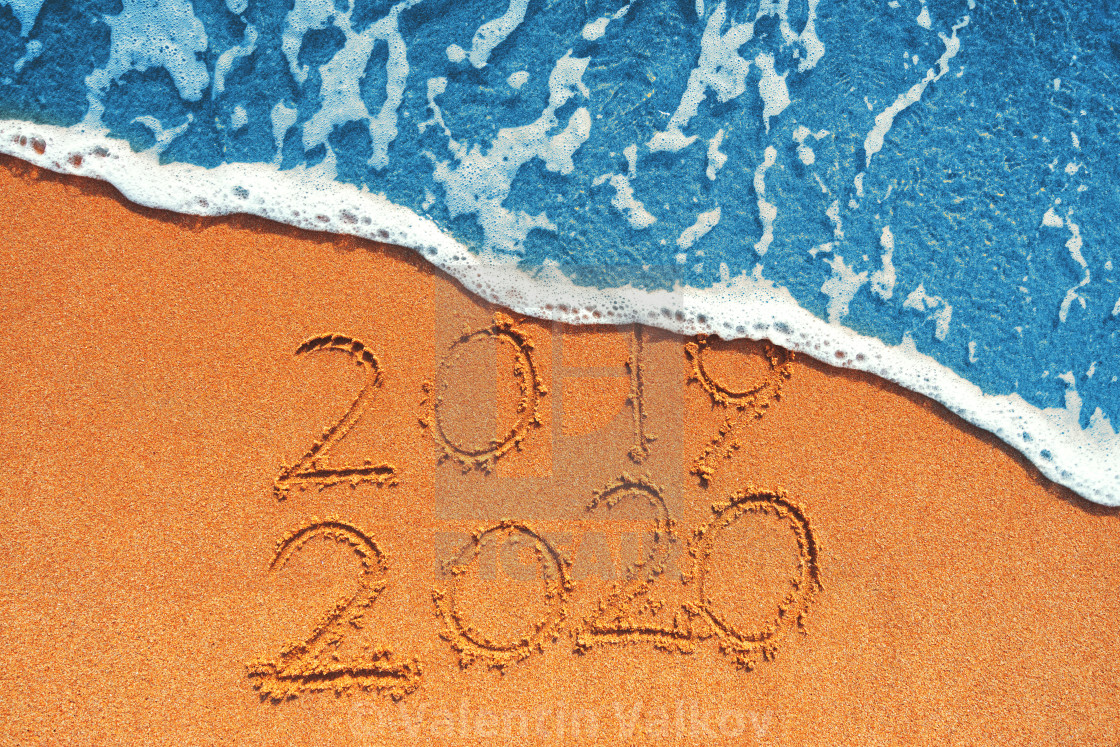 Happy New Year 2020 concept, lettering on the beach. Sea ...