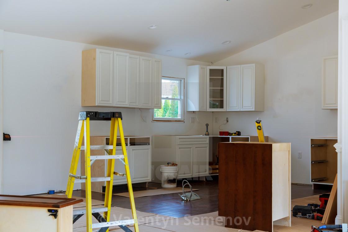 Installation of kitchen cabinet. - License, download or ...