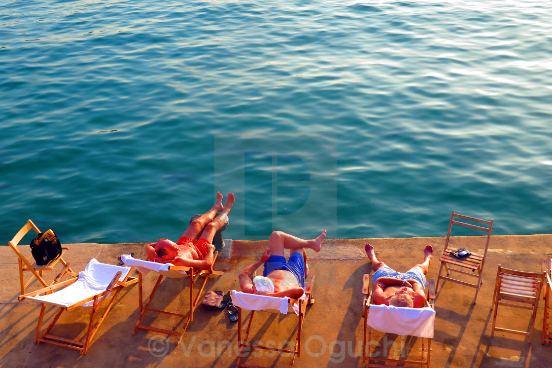 """Sun worshippers"" stock image"