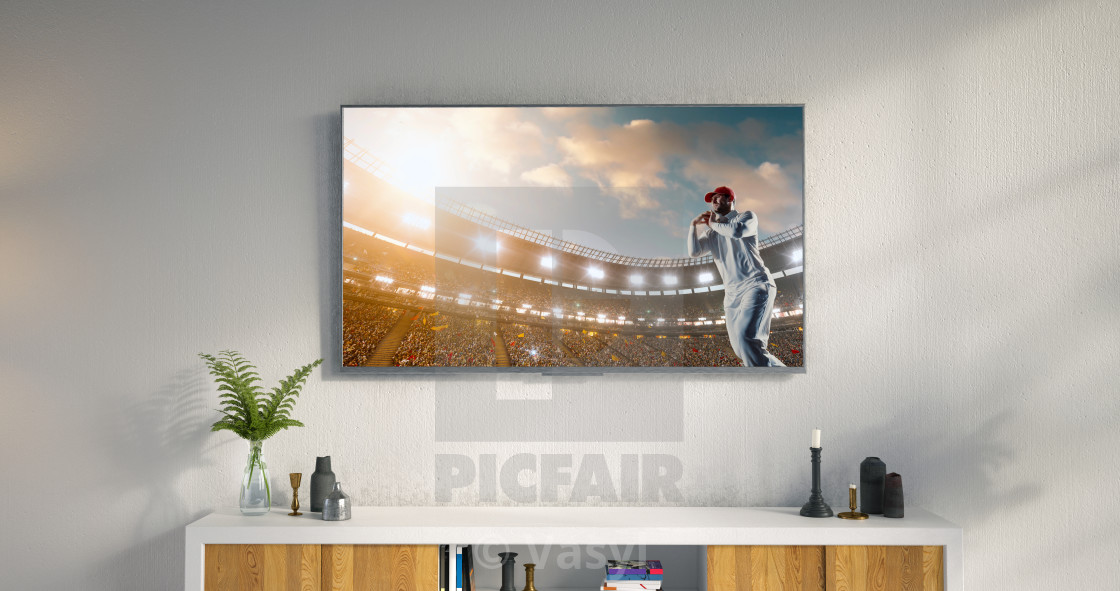 """Living room led tv showing cricket game"" stock image"