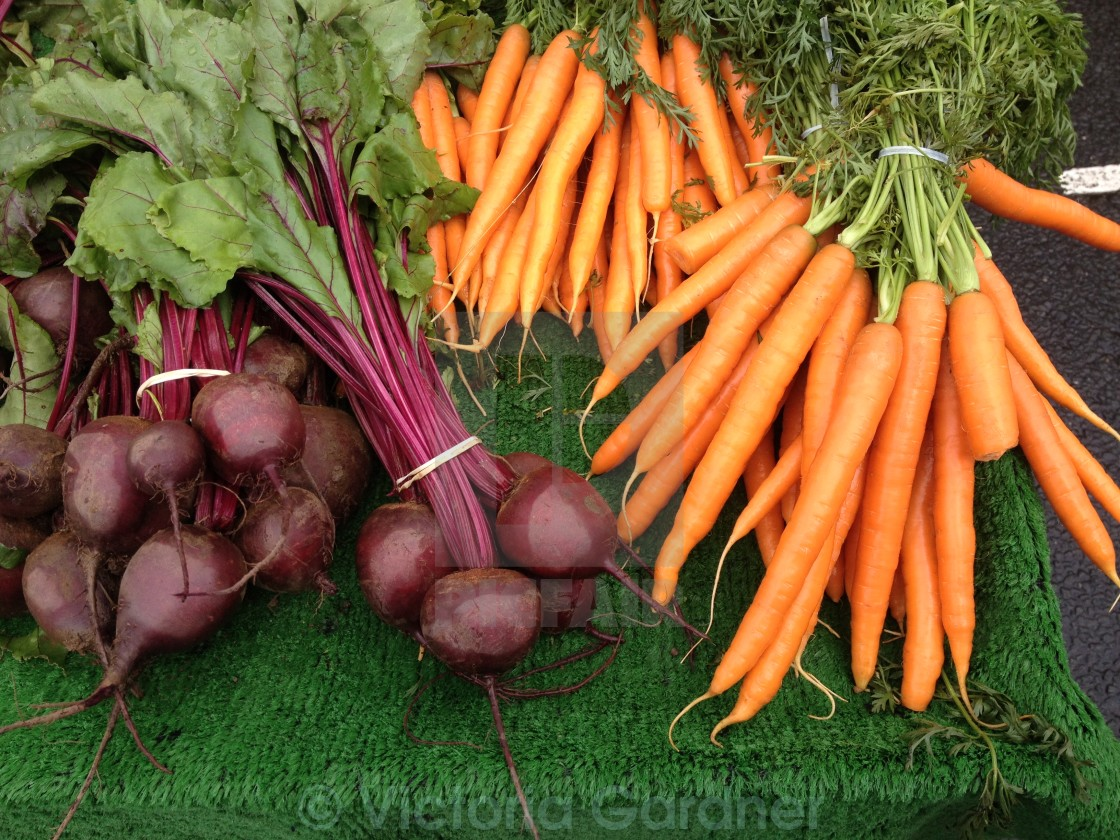 """""""Carrots and beetroot on a stall"""" stock image"""