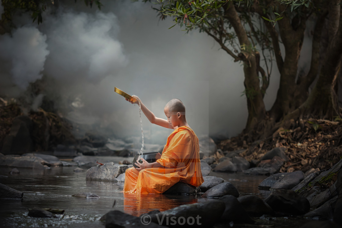 """Asia novice monk in the river."" stock image"