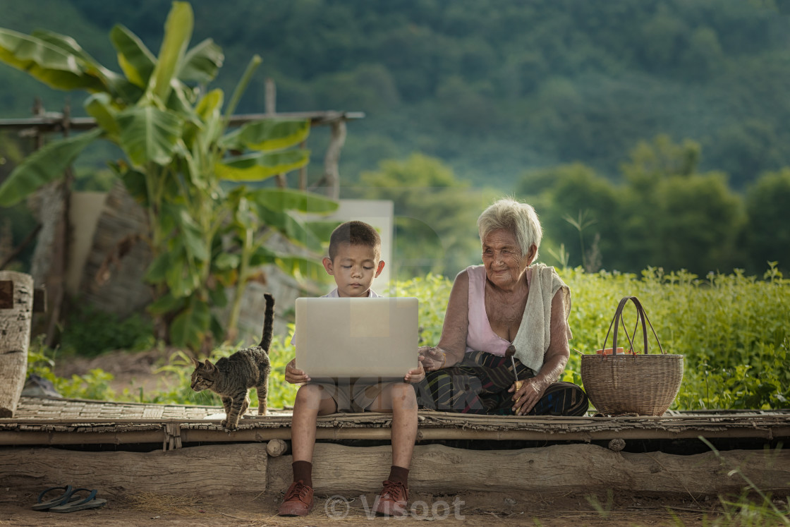 """Country boy with gadgets in the field."" stock image"