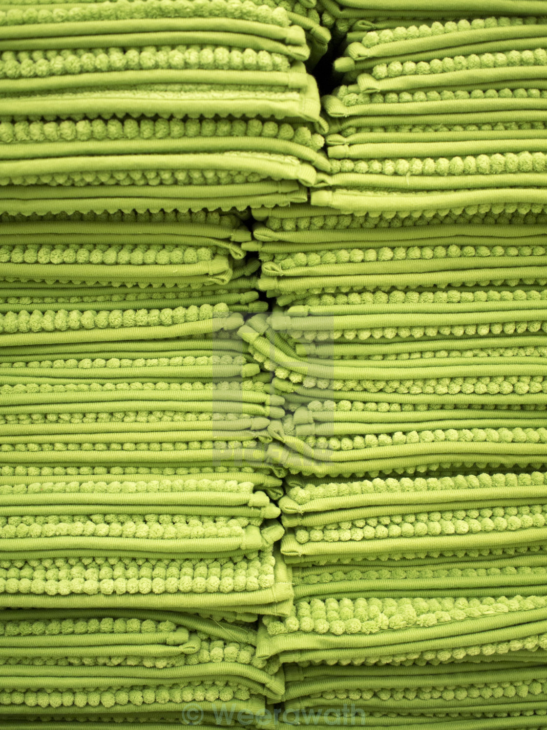 """""""stack of green rugs"""" stock image"""