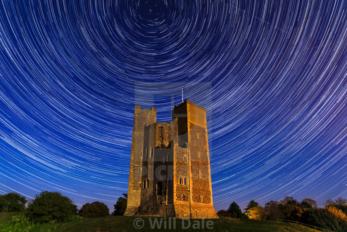 """Orford Castle under a star trail"" stock image"