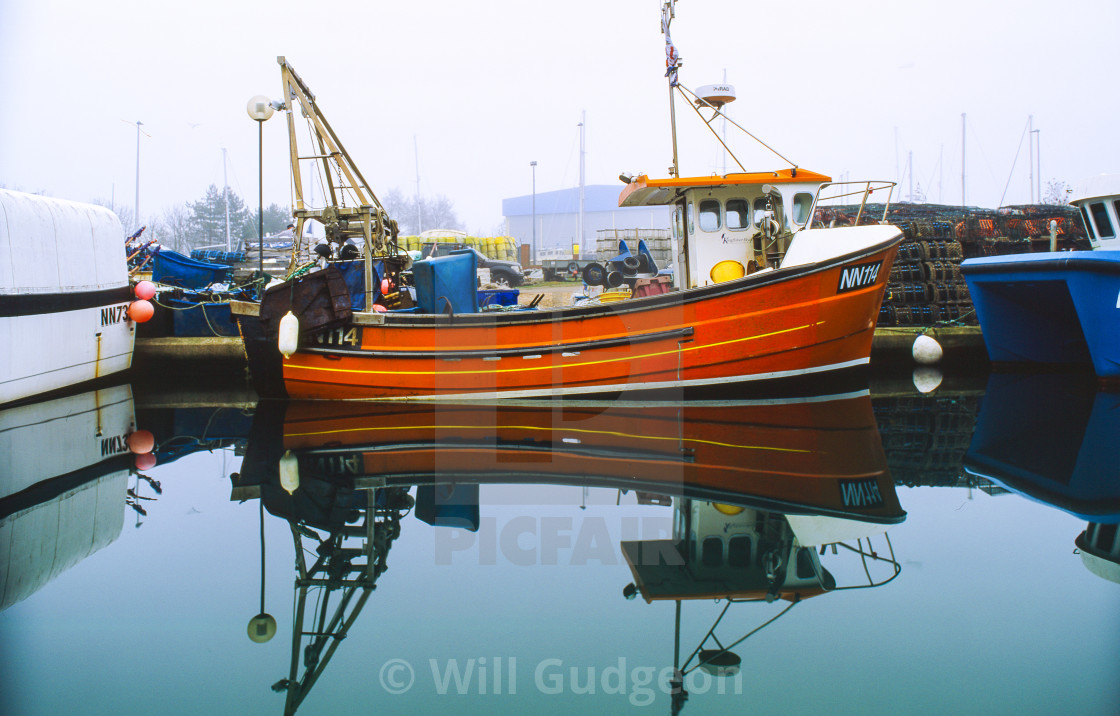 """""""Fishing boat in Eastbourne Sovereign Harbour"""" stock image"""