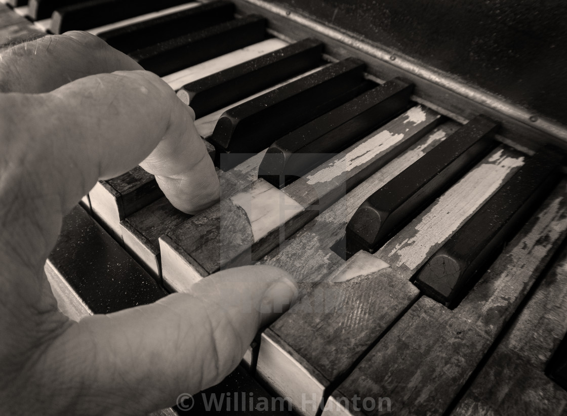 """""""Old Piano, Old Player - Sepia"""" stock image"""