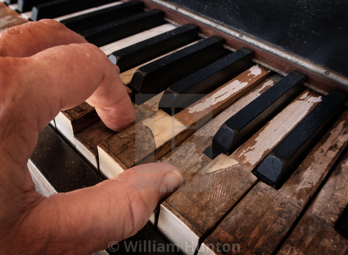 """""""Old Piano, Old Player - Color"""" stock image"""