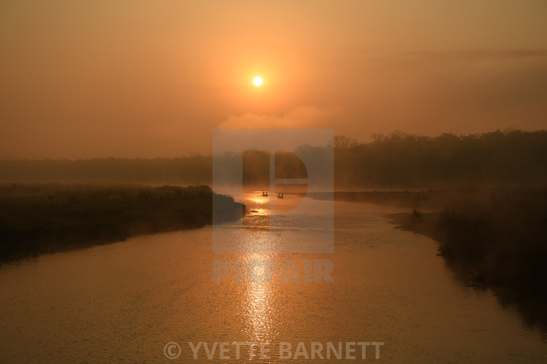 """Sunrise in Chitwan nepal"" stock image"