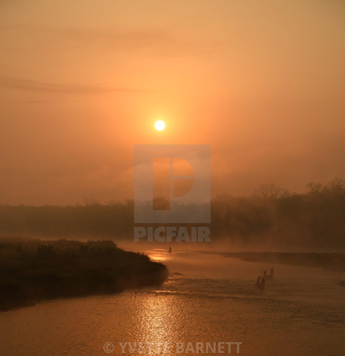 """Sunrise in Chitwan NP"" stock image"