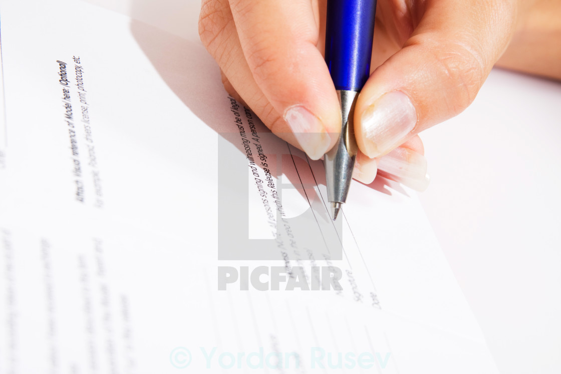 Signing Contract Closeup Agreement With Woman Hand License For