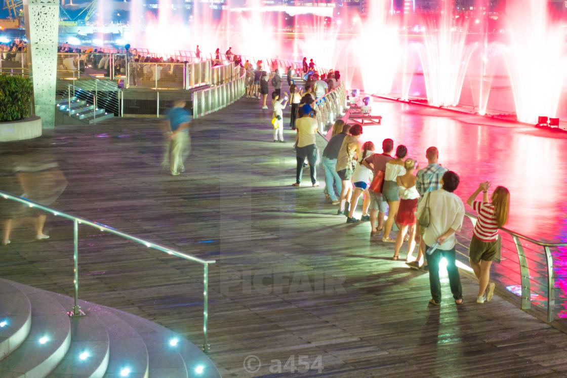 Pedestrian traveler in Singapore city  - License, download