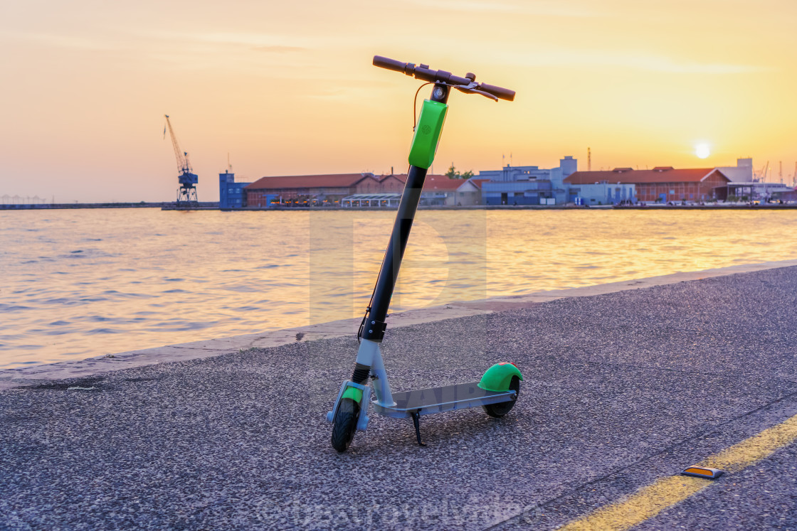 """Parked electric Scooter rental without passenger."" stock image"