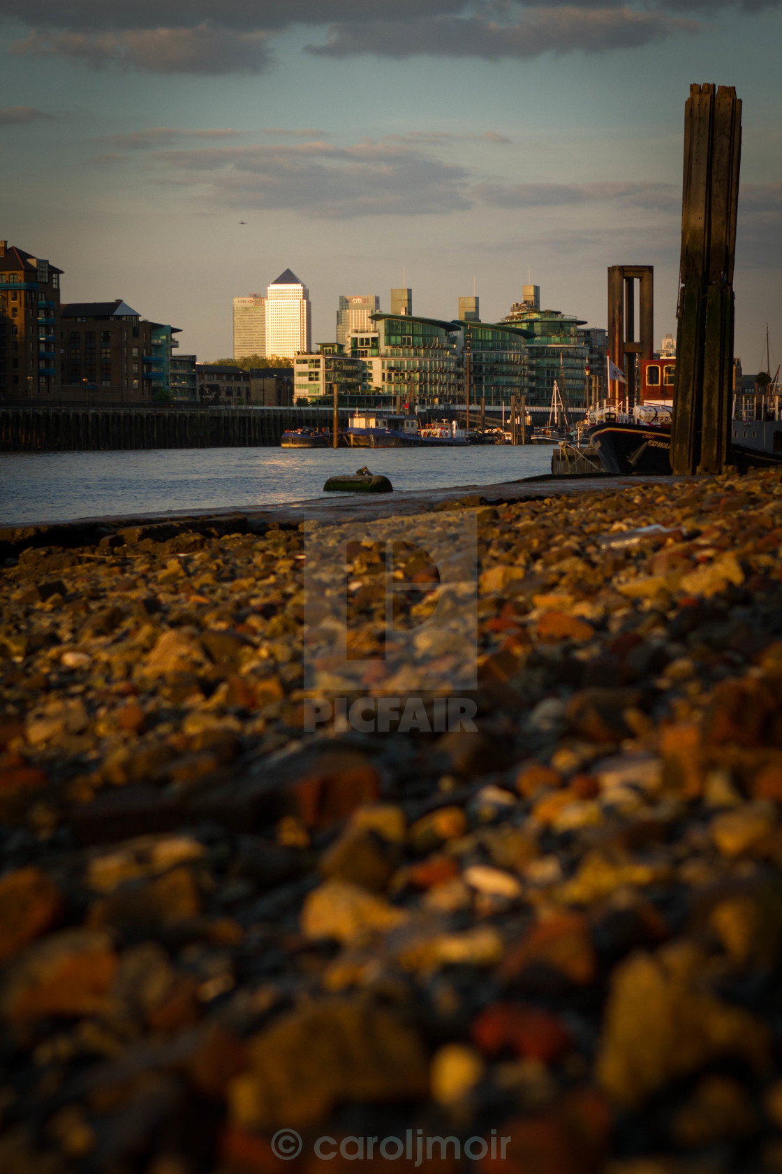 """canary wharf seen from a pebble beach"" stock image"