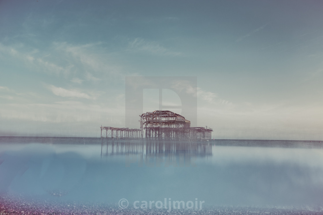 """Reflecting on Brighton West Pier"" stock image"