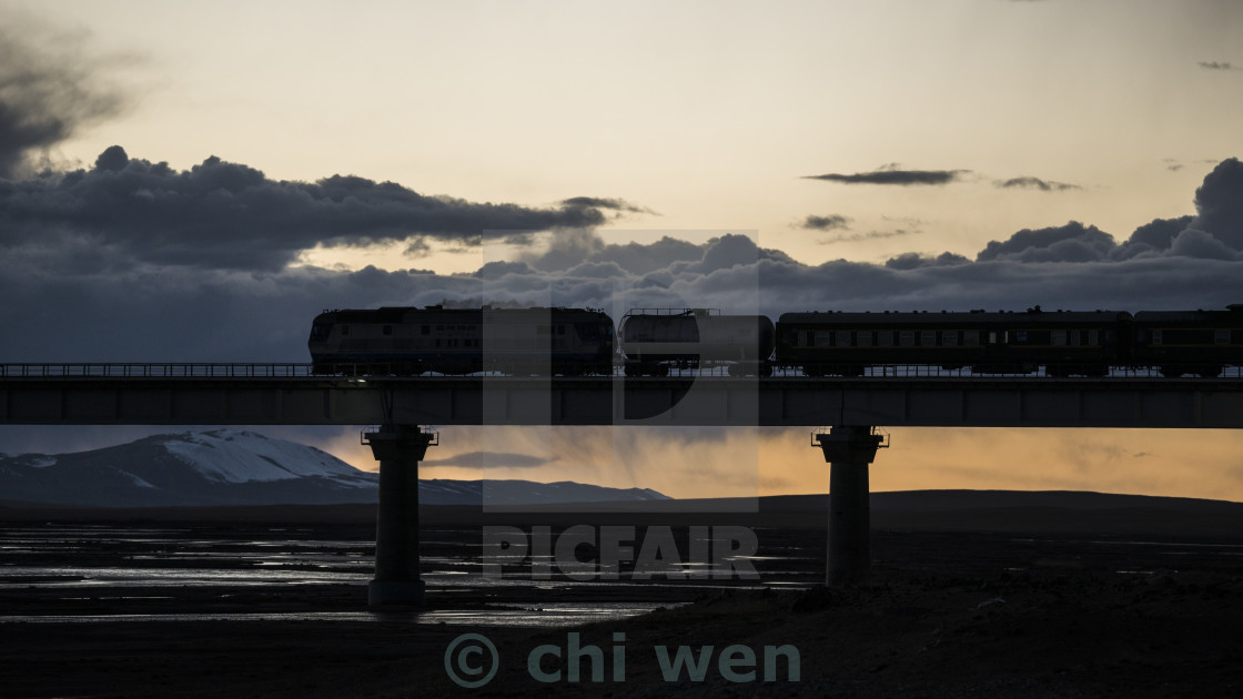 """The Qinghai - Tibet railway, a train is crossing a bridge on the source region of Yangtze River."" stock image"