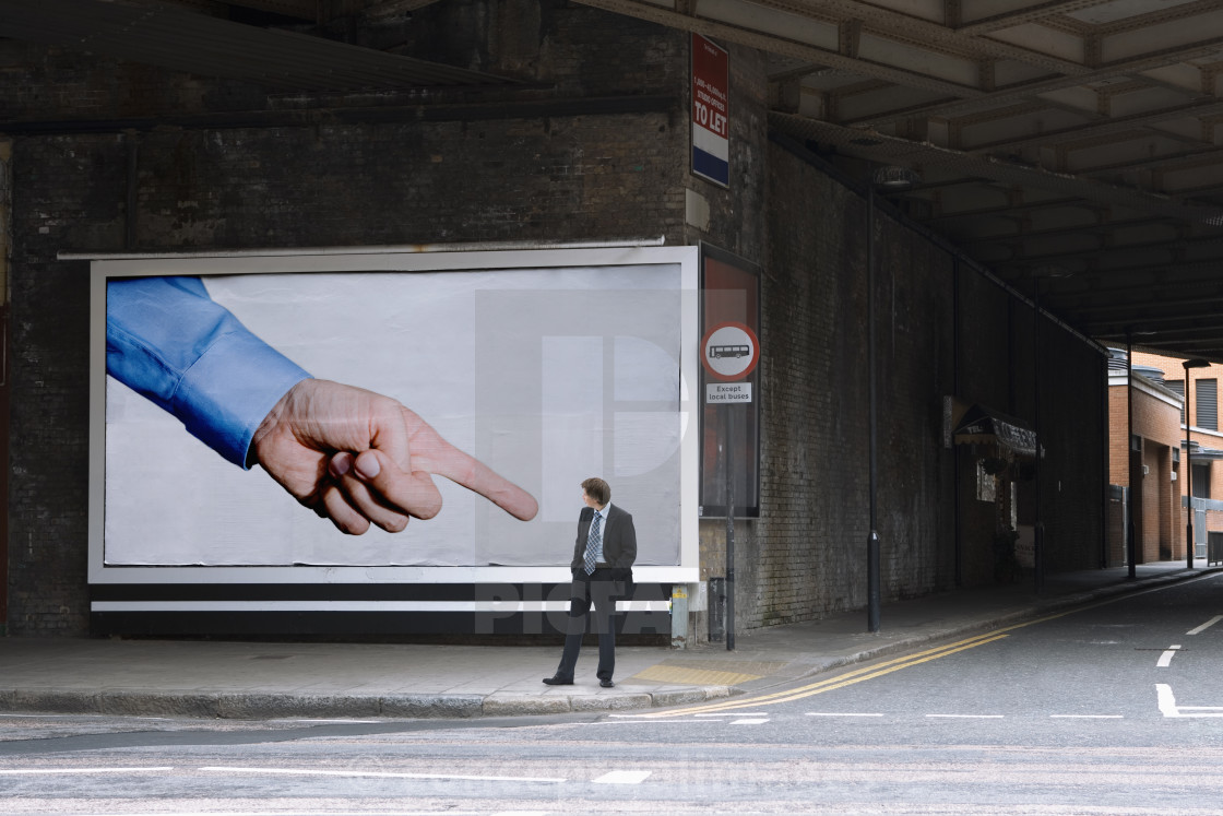 """""""A businessman looking at a billboard"""" stock image"""