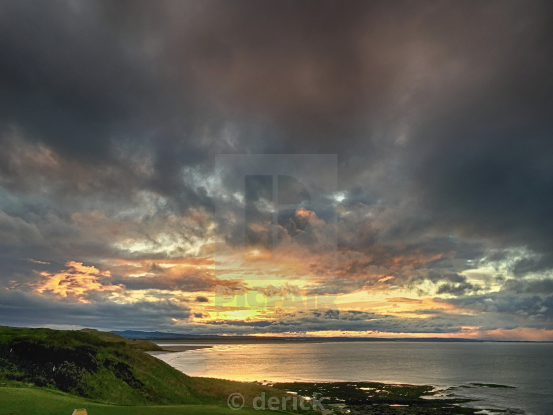Sunset over Budle Bay Northumberland - License, download or