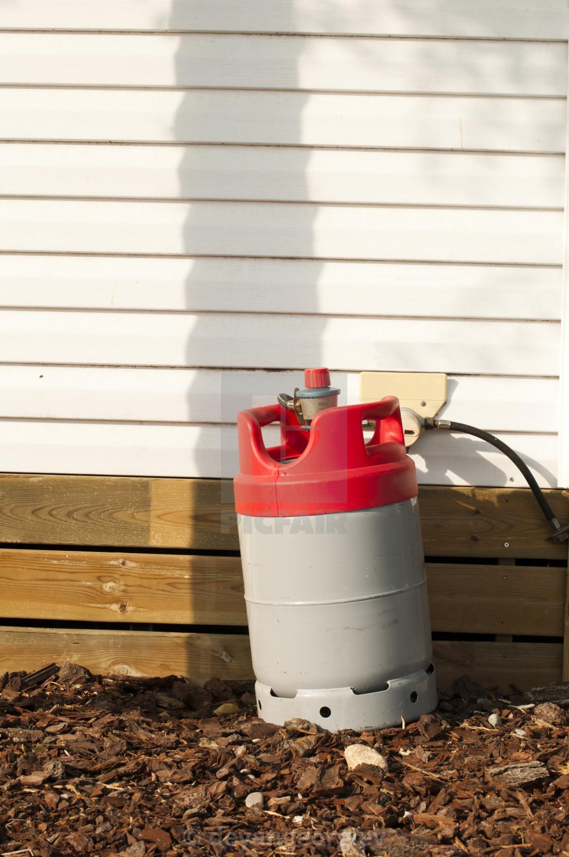 """Gas bottle feeding home"" stock image"