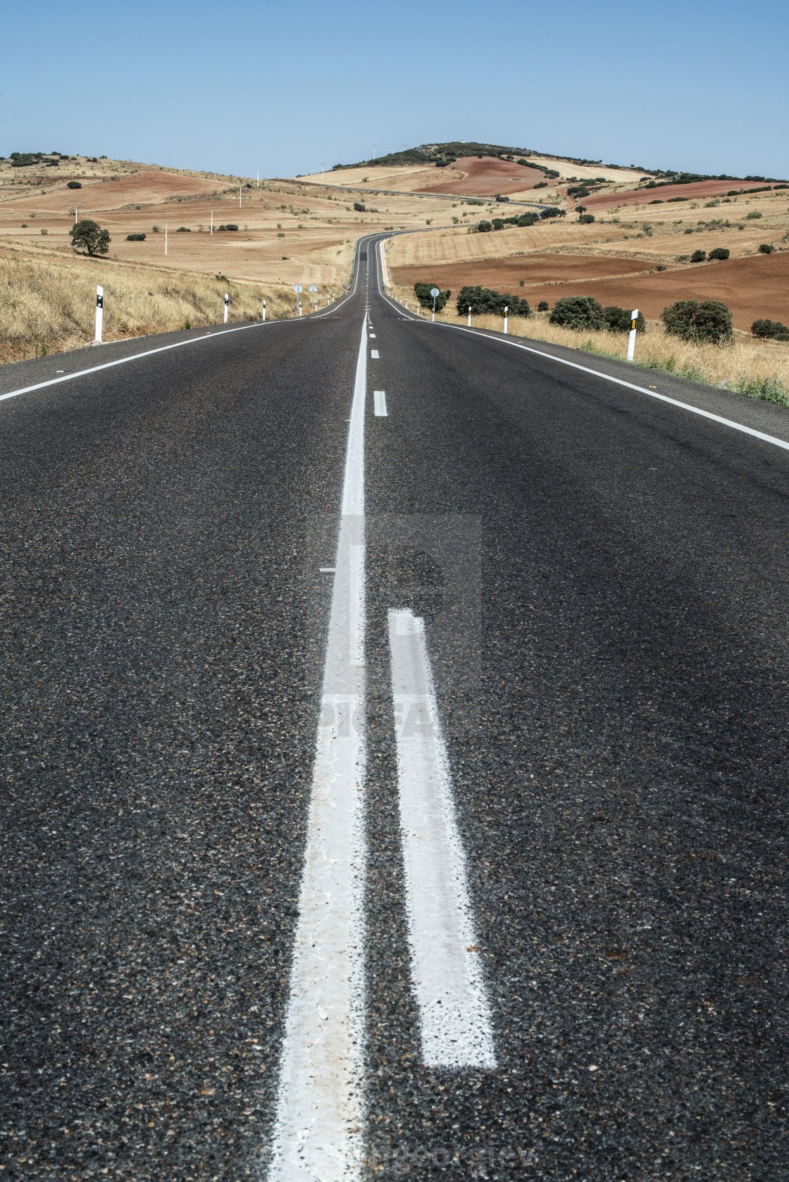 """Long asphalt road."" stock image"