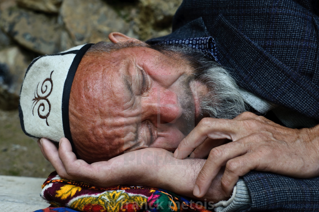 """Man sleeping ( Kyrgyzstan)"" stock image"