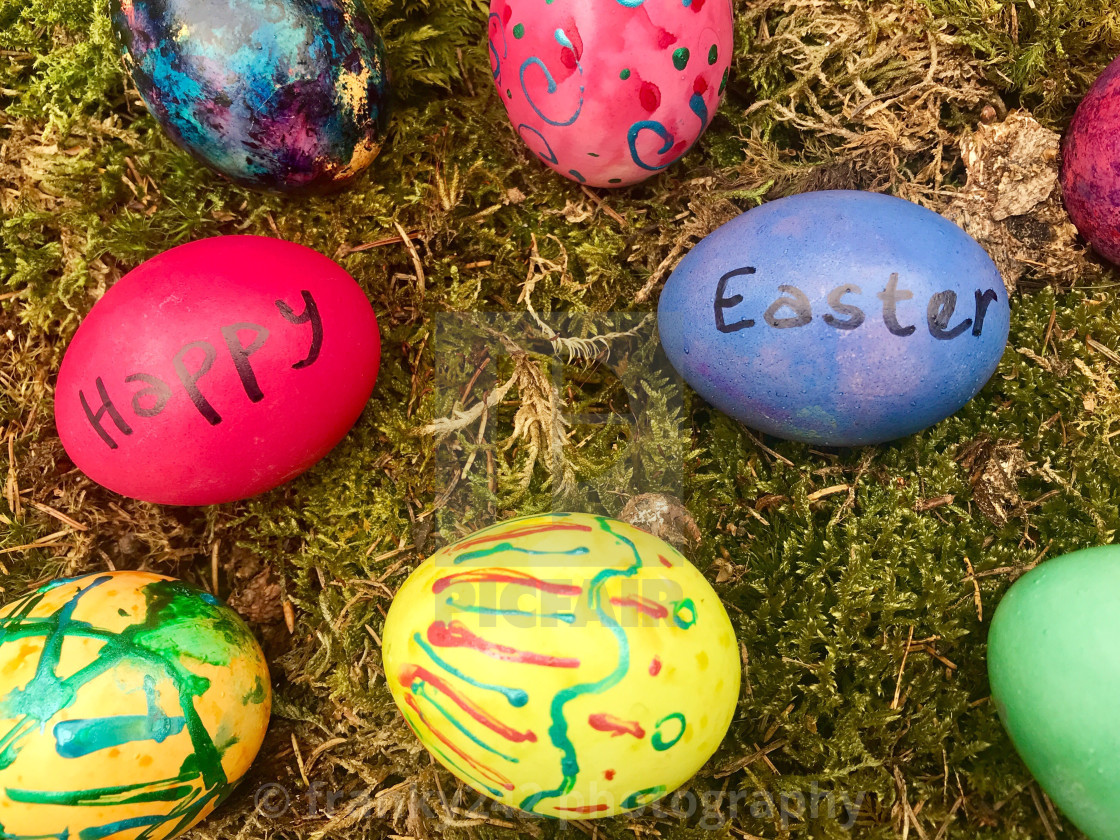 """Happy Easter - Colourful Easter eggs in green moss."" stock image"