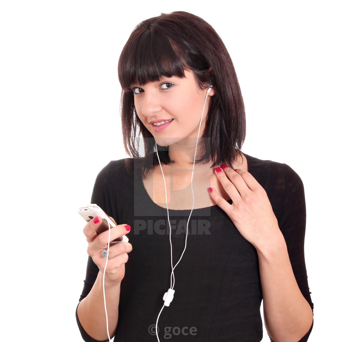 """beautiful girl with phone listening music"" stock image"