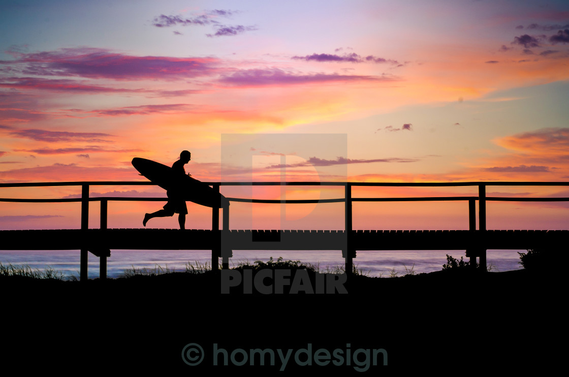 """Surfer running to the beach"" stock image"