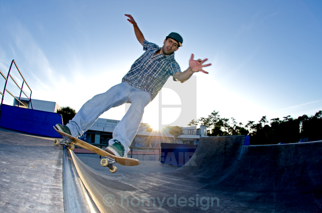 """Skateboarder on a grind"" stock image"