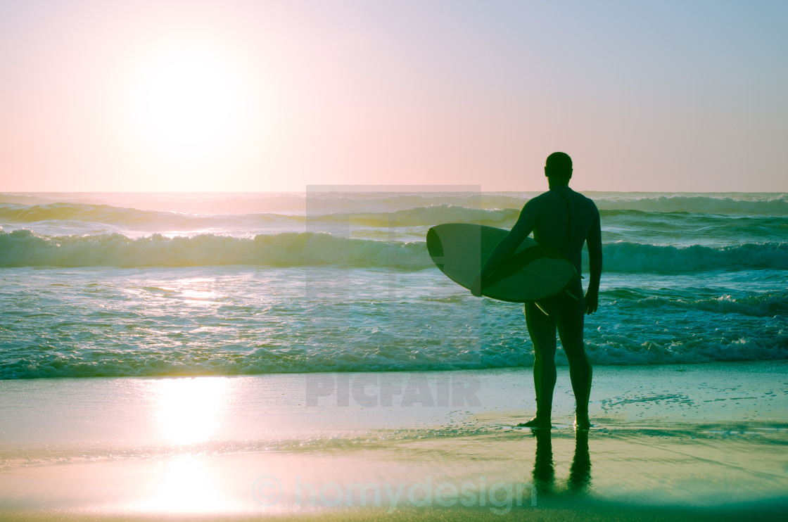 """Surfer watching the waves"" stock image"