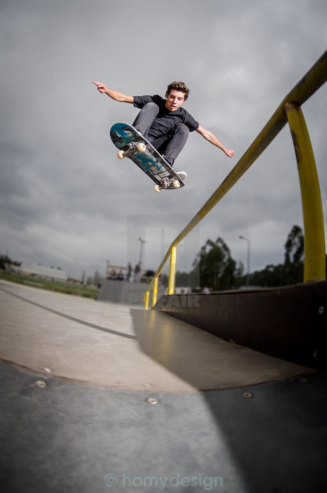 """Skateboarder doing a ollie"" stock image"