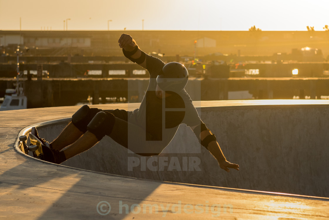 """Skateboarder in a concrete pool"" stock image"