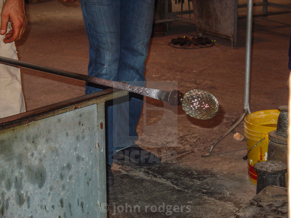 """Glass Blower Rolling Heated Glass For Shaping In Venice Italy.jpg"" stock image"