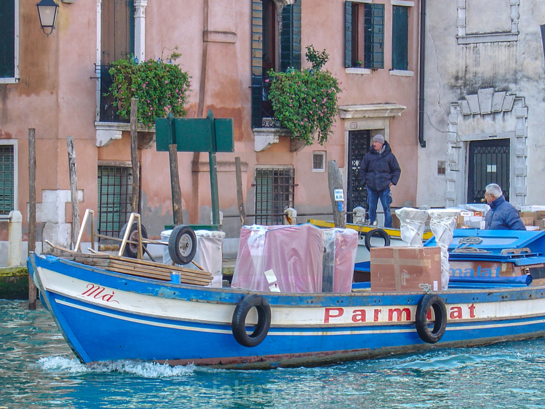 """Boat Making Deliveries In Canals of Venice, Italy"" stock image"