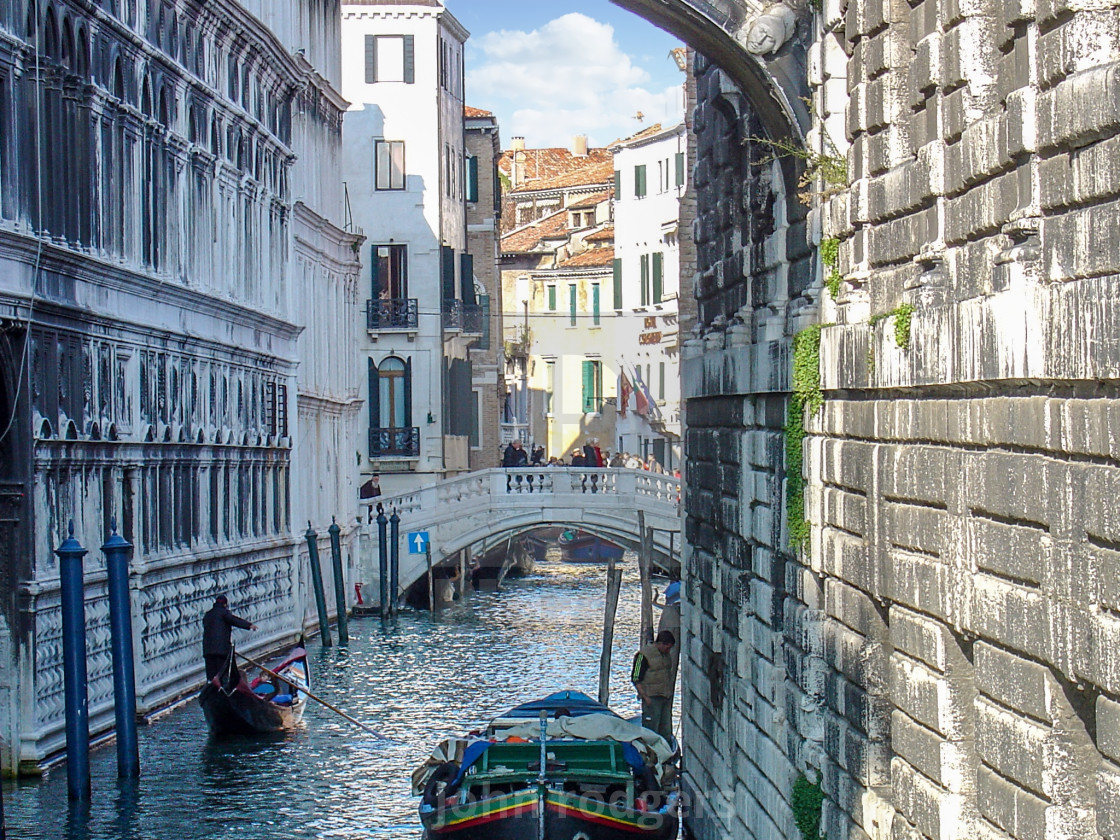 """Shadowed Waterway Inside the City of Venice, Italy"" stock image"