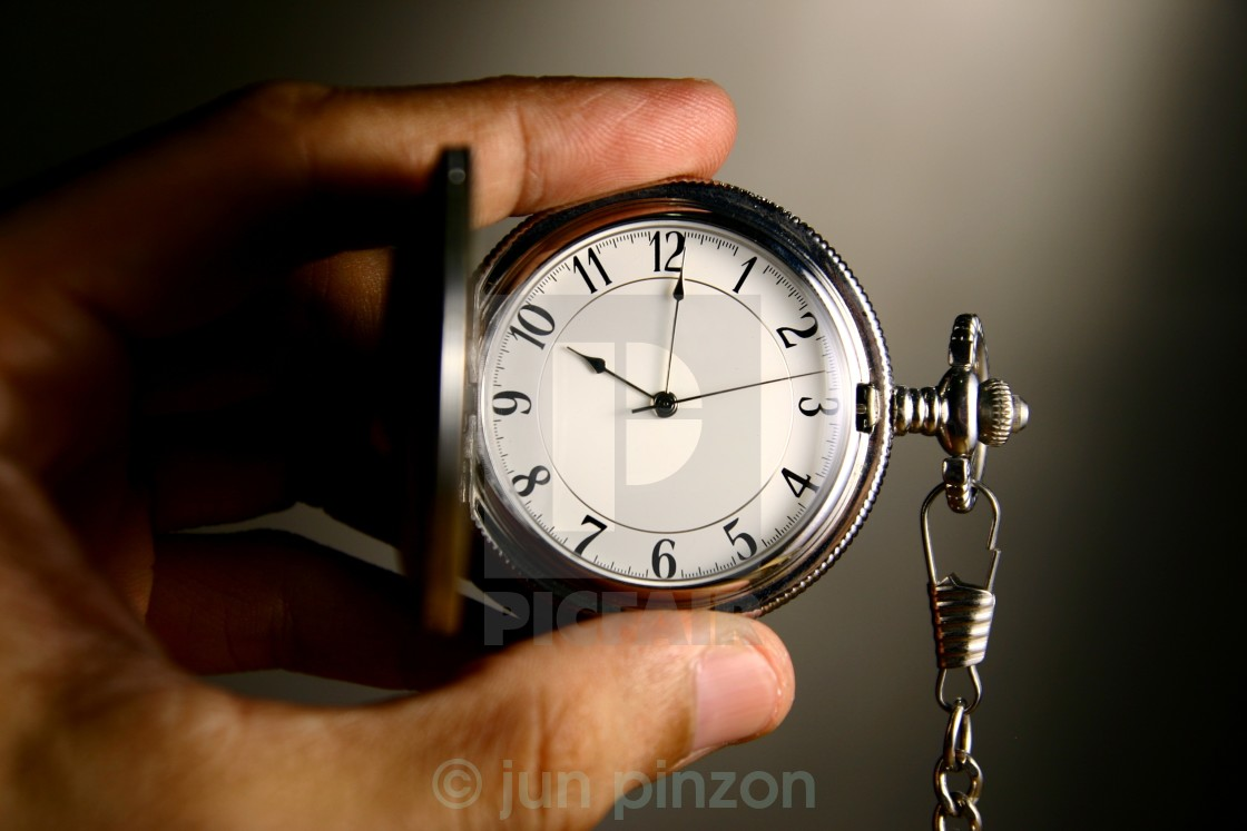 """watch held by hand"" stock image"