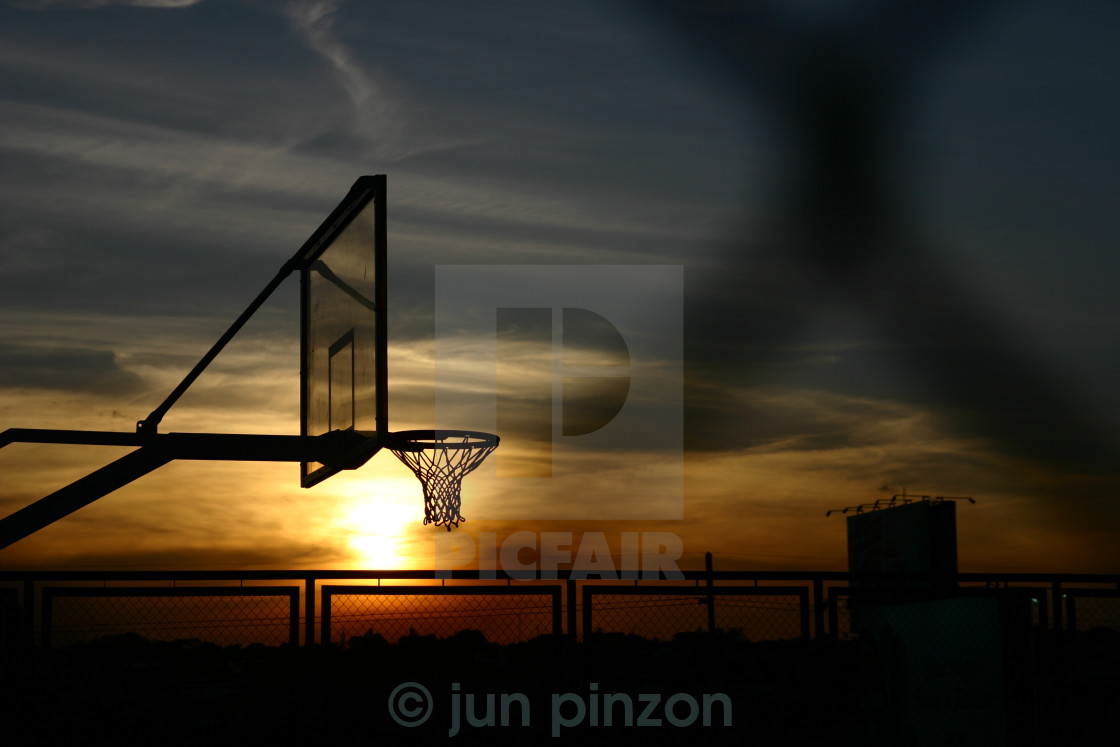 """sunset and a basketball court"" stock image"