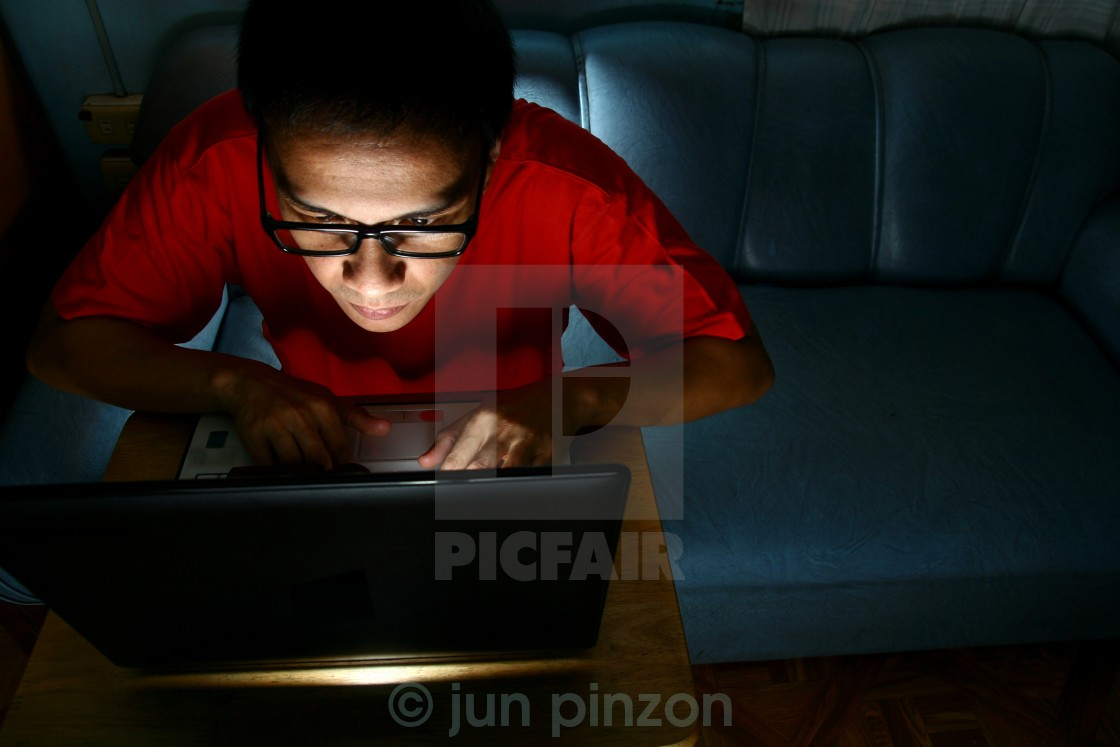 """Man working on a laptop computer"" stock image"