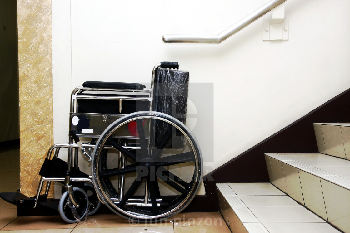 """""""A wheelchair and a set of staircase."""" stock image"""