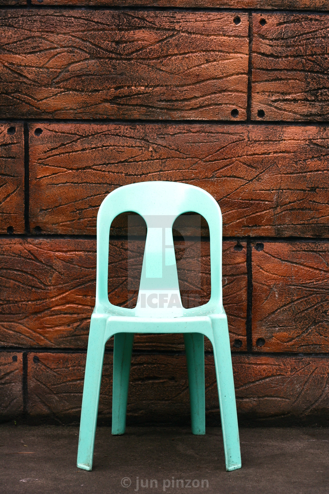 """""""Plastic chair and a brown wall"""" stock image"""
