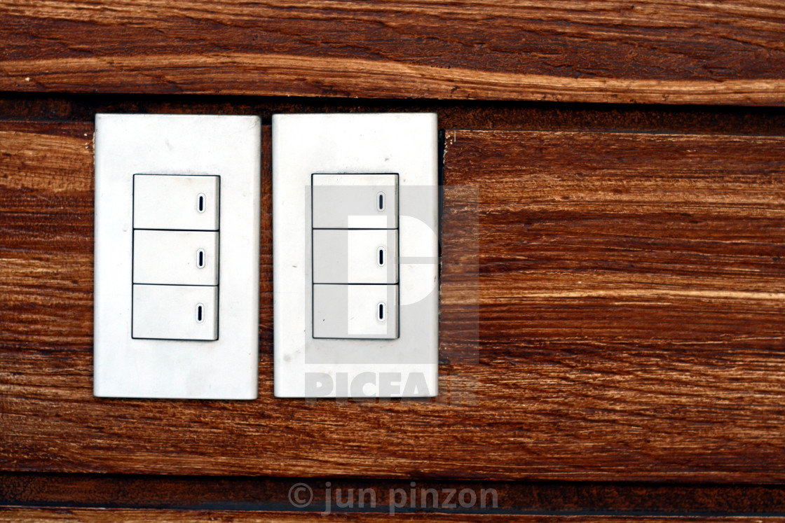 """""""Light switches on a concrete wall"""" stock image"""