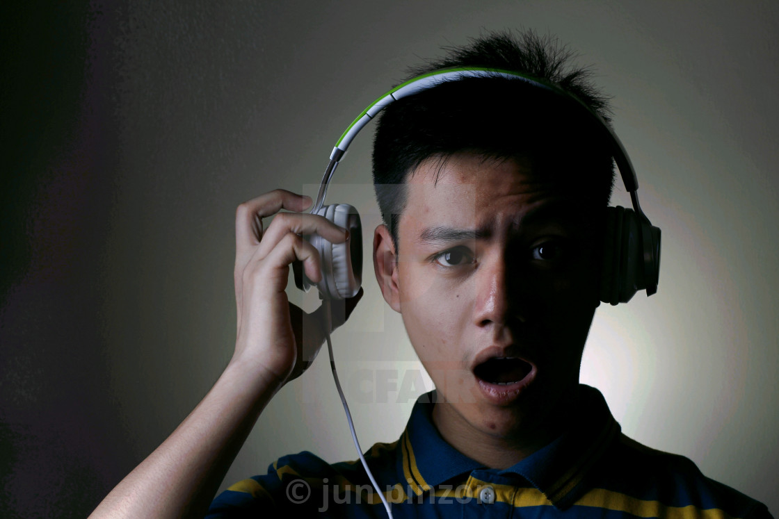 """Male Teenager with headphones"" stock image"