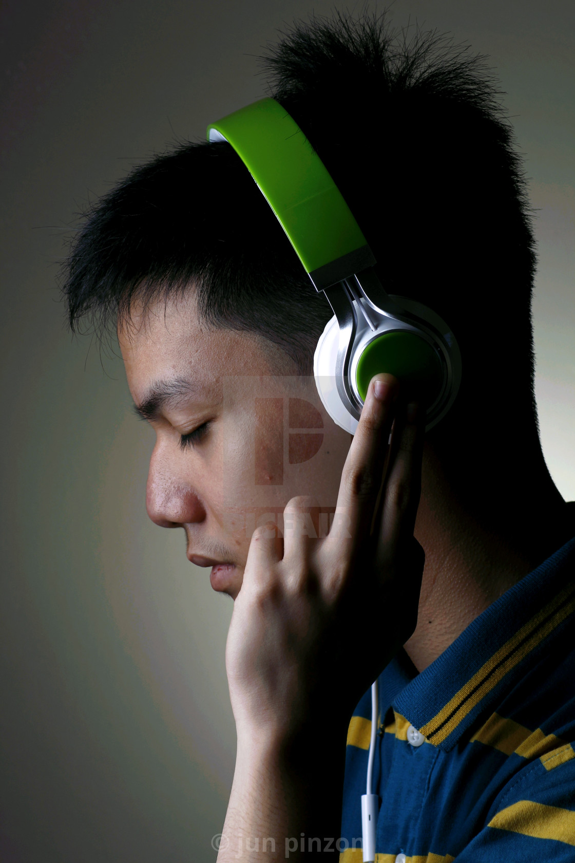 """Male Teenager with headphones"" stock image"