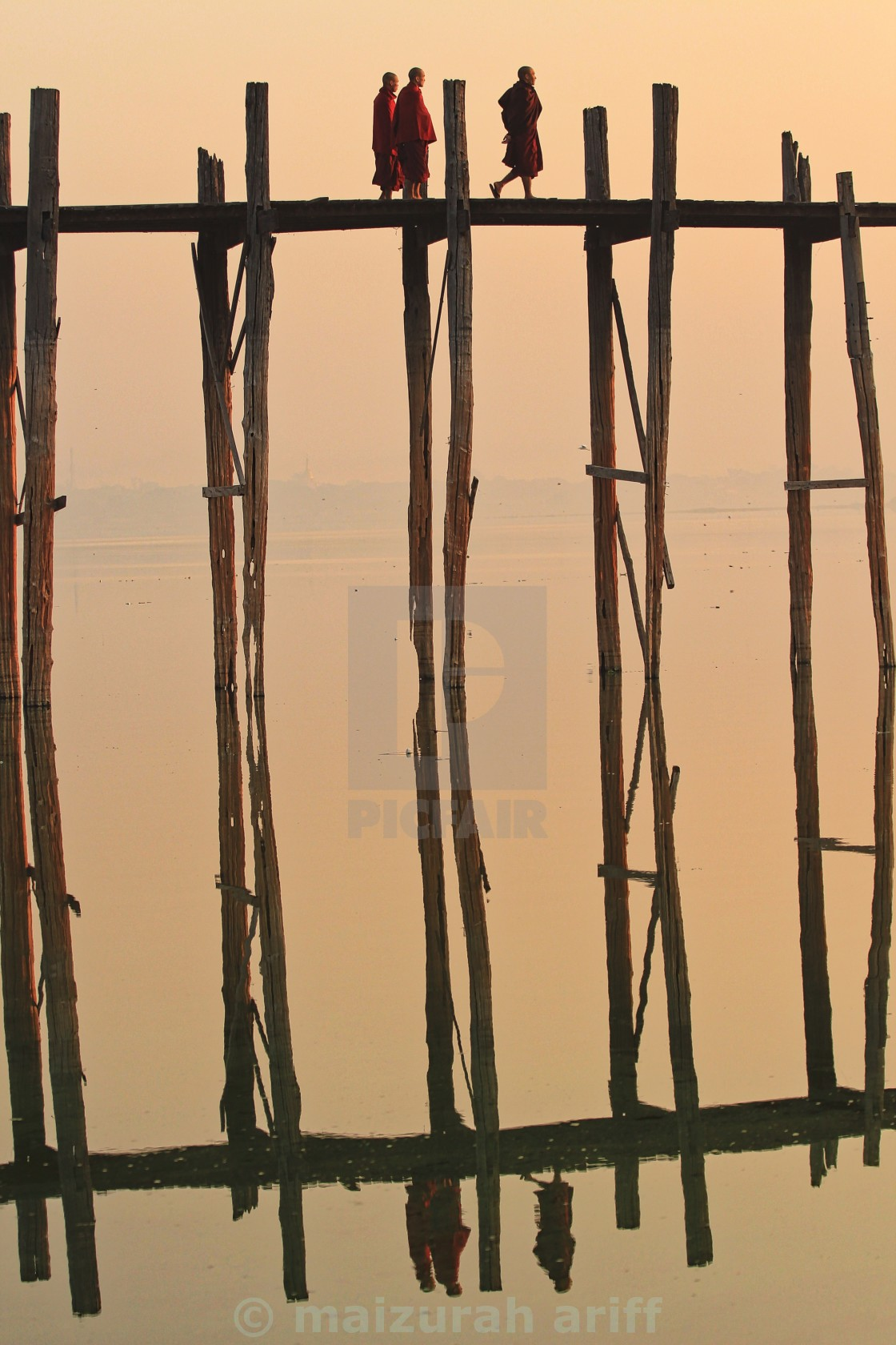 """reflection of monks walking on u bien bridge"" stock image"