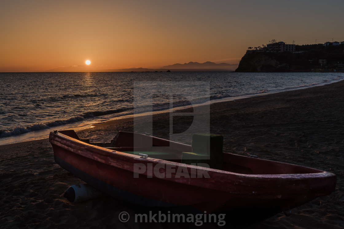 """The boat on the beach at sunrise"" stock image"