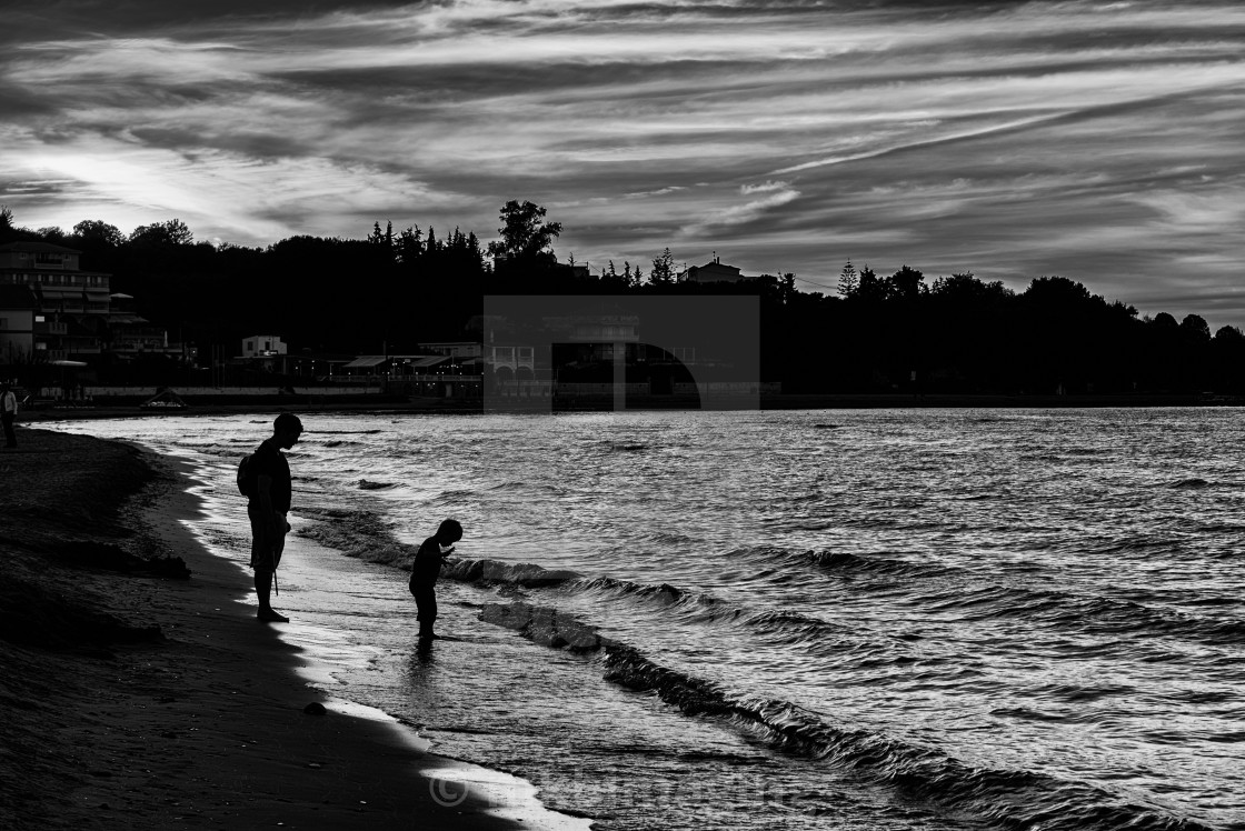 """""""Father and son at the waters edge"""" stock image"""