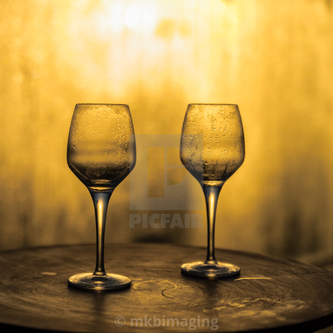"""""""Wine glasses on a wooden table"""" stock image"""