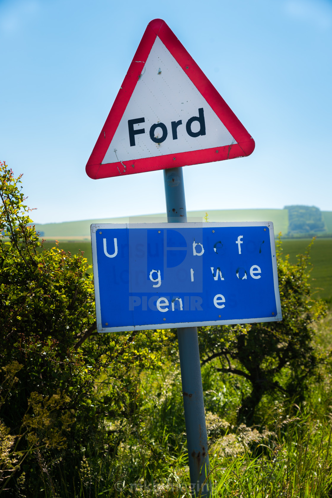 """Dilapidated Road Sign"" stock image"