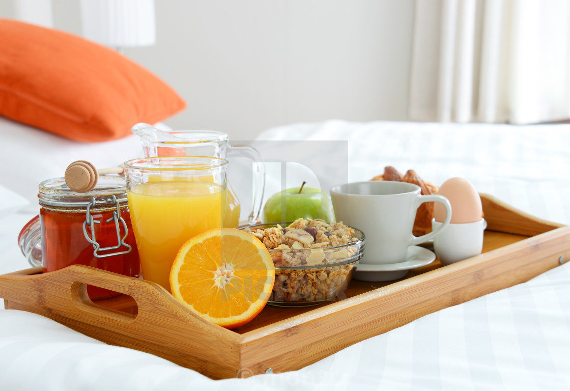 """Breakfast in bed in hotel room."" stock image"