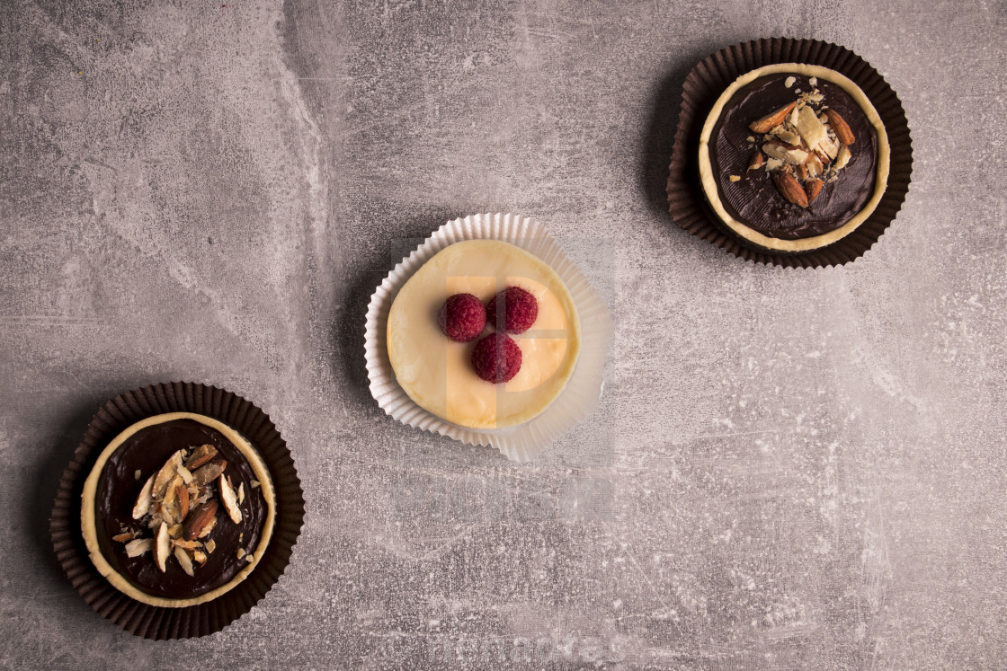 """Mini tarts on rustic grey background"" stock image"